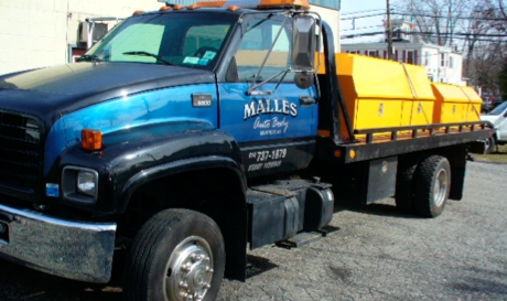 Malles Auto Body & Towing - Flatbed